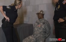 Horny cops arrest a military dude for having a big black cock hiding inside his pants and ready