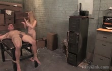 Voluptuous domina slapping around a tied dude