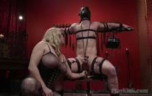Busty Blonde Domina Securing a Guy