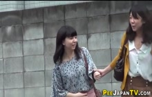 Asian babes squat and piss in public toilet