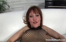 Redhead in fishnets fucked in the ass